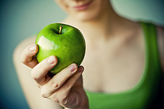 Green Granny Smith apple with girl